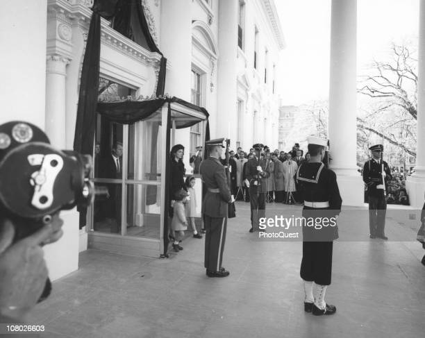 Jacqueline Kennedy accompanied by her children John Kennedy Jr and Caroline Kennedy and her brotherinlaw Ted Kennedy leaves the White House for the...