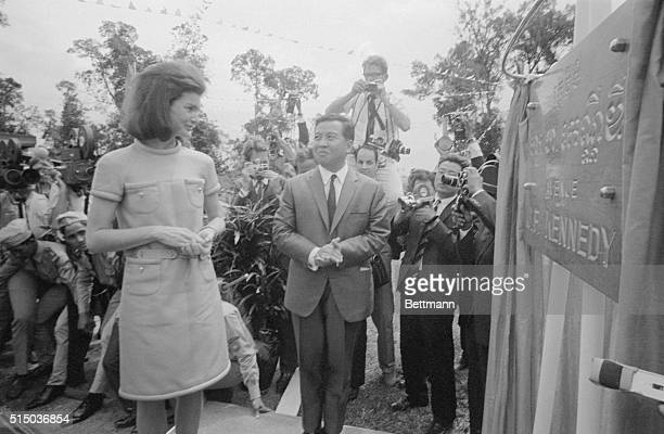 Jacqueline Kennedy admires the plaque dedicated to her late husband by Cambodian Chief of State Prince Sihanouk during ceremonies naming a street...