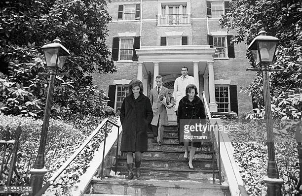 Jacqueline Kennedy and her sister Lee Radziwill are shown leaving the new Georgetown home here 12/18 which Mrs Kennedy recently purchased The former...