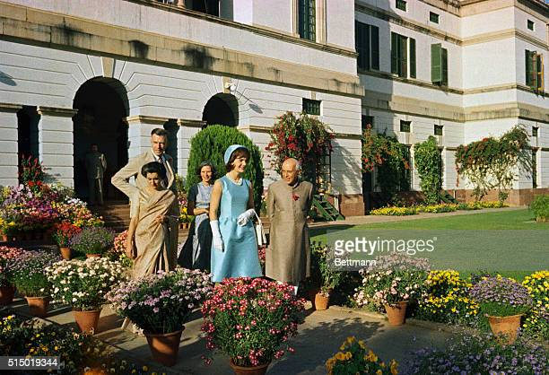 Jacqueline Kennedy and Prime Minister Nehru walk through the gardens of the Presidential Palace in New Delhi.
