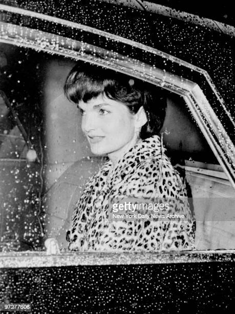 Jacqueline Kennedy in her limousine outside the Carlyle Hotel