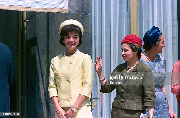 Jacqueline Kennedy in yellow during a state visit to France at the Palais de l'Elysee