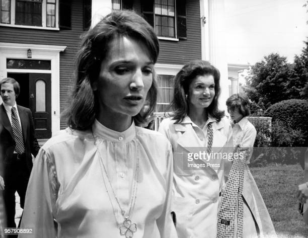 Jacqueline Kennedy Onassis and her sister Lee Radziwill exit a Howard Johnson after Caroline Kennedys Graduation from Concord Academy on June 5 1975...