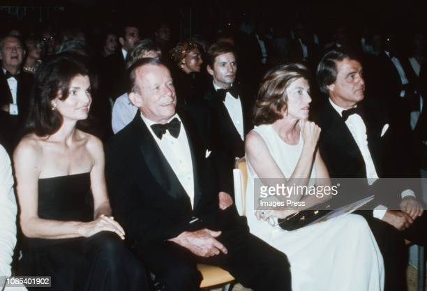 Jacqueline Kennedy Onassis, artist William Walton, Eunice Kennedy Shriver and Sargent Shriver attends the Valentino Fashion Show Benefit for the...
