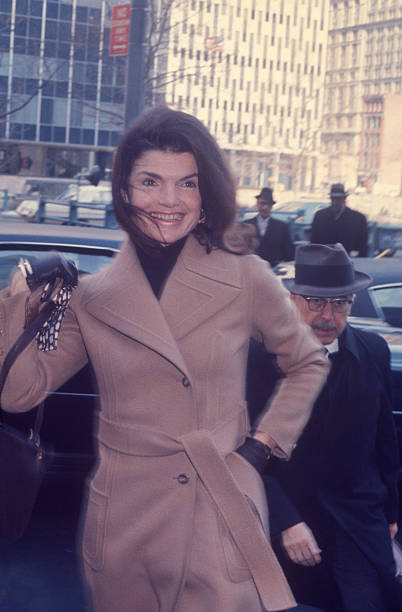 Jacqueline Kennedy Onassis  was on cover of LIfe Magazine  coming out of courthouse with lawyer in the background
