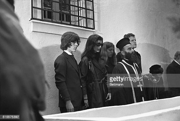 Jacqueline Kennedy Onassis attends the funeral of her second husband Aristotle Onassis accompanied by her daughter Christine and son John Jr and...