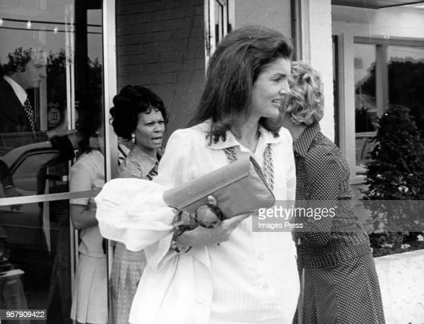 Jacqueline Kennedy Onassis exits a Howard Johnson after Caroline Kennedys Graduation from Concord Academy on June 5 1975 in Concord Massachusetts