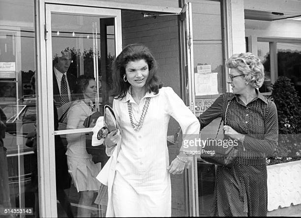 Jacqueline Kennedy Onassis exits a Howard Johnson restaurant after having a meal there after Caroline Kennedys Graduation from Concord Academy on...
