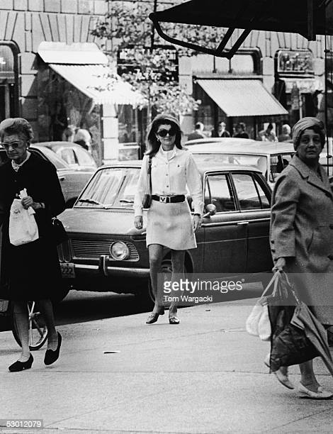 Jacqueline Kennedy Onassis , former US first lady and the wife of Greek shipping magnate Aristotle Onassis, on a sidewalk, early 1970s.