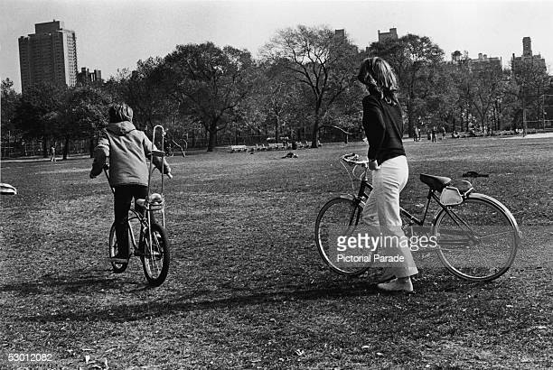 Jacqueline Kennedy Onassis , former US first lady and the wife of Greek shipping magnate Aristotle Onassis, and her son, John F. Kennedy Jr., ride...