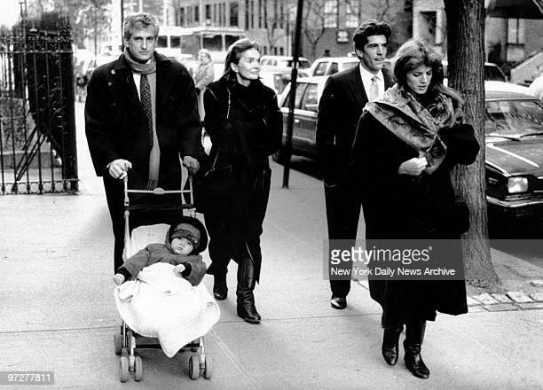 Jacqueline Kennedy Onassis her son John F Kennedy Jr daughter Caroline and Caroline's husband Edwin Schlossberg pushing their daughter Rose leave St...