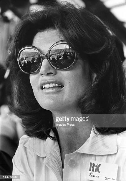 Jacqueline Kennedy Onassis in huge sunglasses attends the Robert F Kennedy Pro Celebrity Tennis Tournament at Forest Hills Stadium circa August 1975...