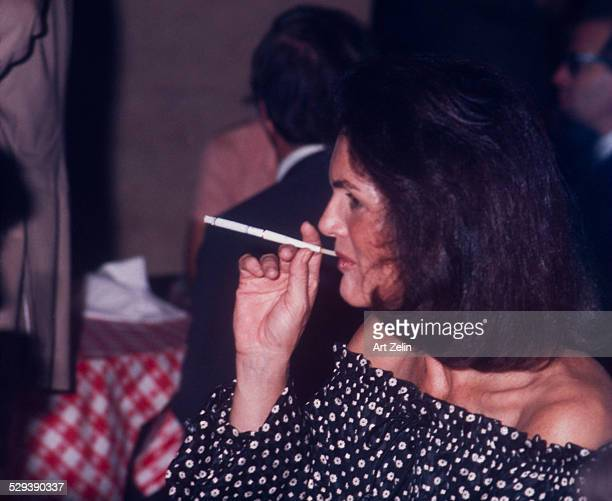 Jacqueline Kennedy Onassis smoking a cigarette rare to see circa 1970 New York