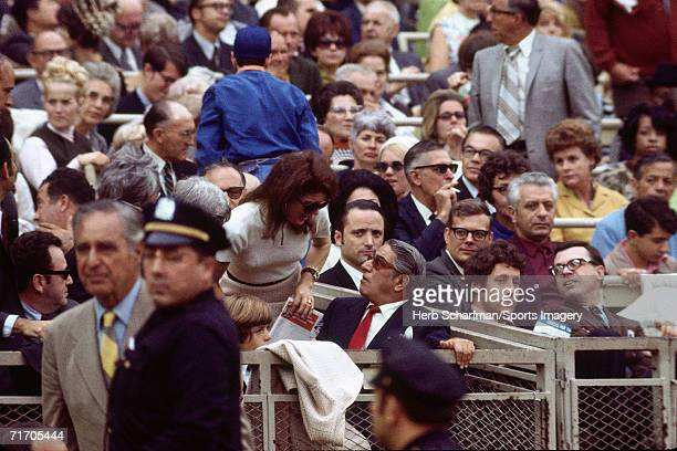 Jacqueline Kennedy Onassis talks with Aristotle Onassis at Shea Stadium during a 1969 New York Mets baseball game in Flushing New York