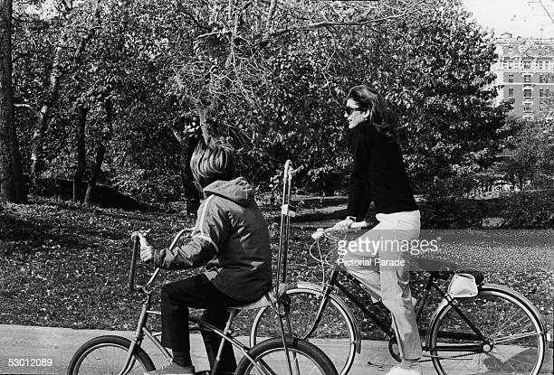 Jacqueline Kennedy Onassis , the wife of Greek shipping magnate Aristotle Onassis and former US first lady, and her son, John F. Kennedy Jr., on a...