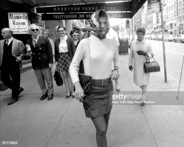 Jacqueline Kennedy Onassis walks out of Cinema Rendezvous theater on W 57th St after seeing I Am Curious