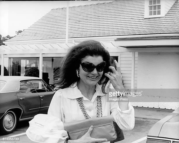 Jacqueline Kennedy Onassis wearing sunglasses exits a Howard Johnson restaurant after having a meal there after Caroline Kennedys Graduation from...