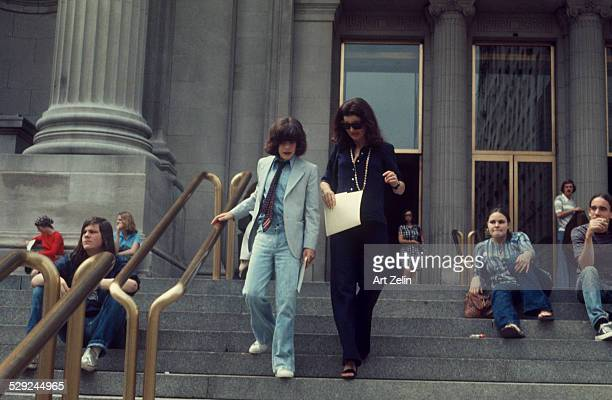 Jacqueline Kennedy Onassis with John F Kennedy; Jr. Leaving the Metropolitan Museum of Art; circa 1970; New York.