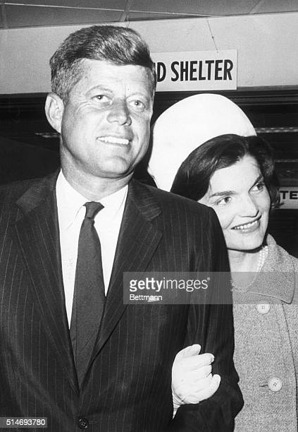 Jacqueline Kennedy rests her head on husband John F Kennedy's shoulder after his arrival into New York to campaign as the presidential candidate