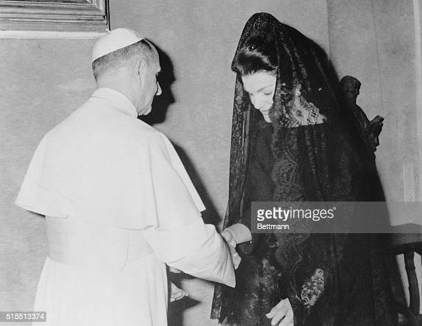 Jacqueline Kennedy, wearing a Spanish style mantilla, bows her head as she is greeted by Pope Paul VI during audience with the pontiff January 31st....