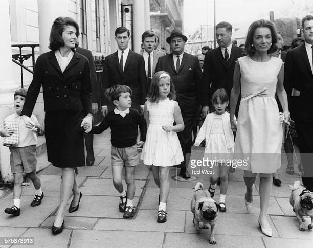 Jacqueline Kennedy widow of former US President John F Kennedy with her sister Princess Lee Radziwill and children Caroline and John all walking...