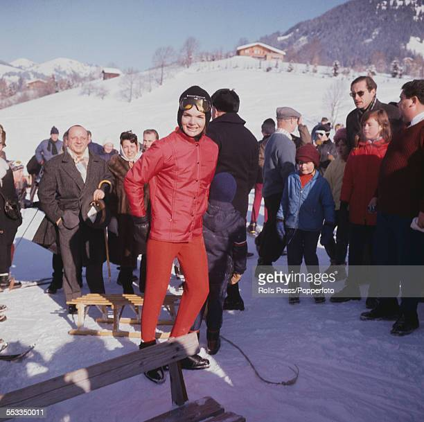 Jacqueline Kennedy widow of President John F Kennedy pictured holding a sled on the ski slopes at Gstaad Switzerland during a vacation with her two...