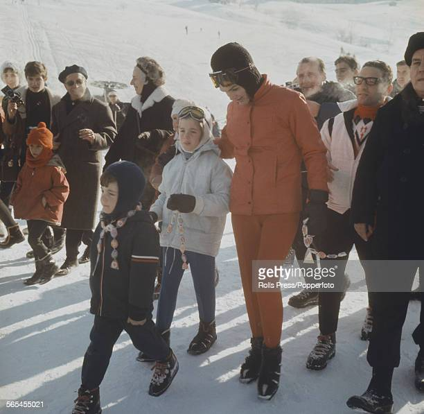 Jacqueline Kennedy widow of President John F Kennedy pictured with her daughter Caroline Kennedy and son John F Kennedy Jr on the ski slopes at...