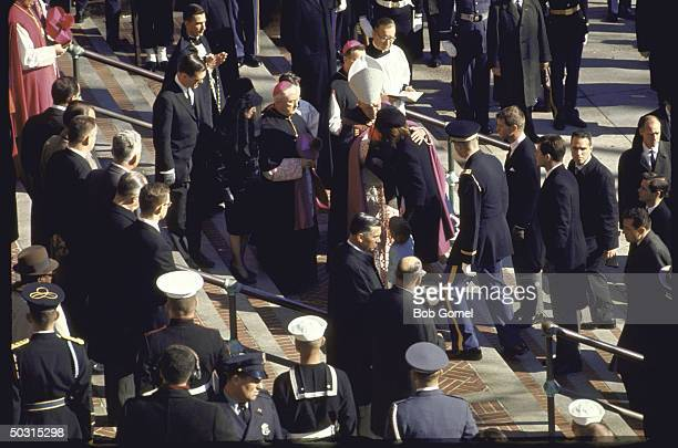 Jacqueline Kennedy with John Jr and Caroline with Richard Cardinal Cushing Rose Kennedy Sargent Shriver Robert and Edward Kennedy outside St Mathews...