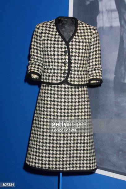Jacqueline Kennedy wore this blackandwhite houndstooth wool tweed suit with black braided trim by Bob Bugnand inspired by the classic Chanel suit...