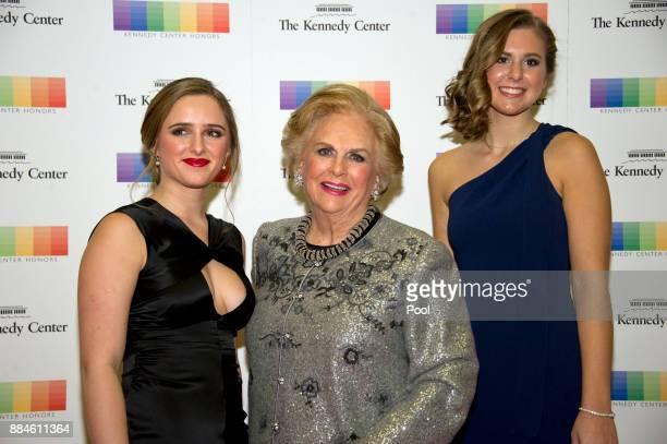 Jacqueline Mars center and her granddaughters Graysen Airth left and Katherine Burgstahler right arrive for the formal Artist's Dinner honoring the...