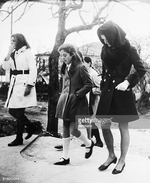 Jacqueline Onassis and her daughter Caroline Kennedy head back to Aristotle Onassis' yacht Christina with Aristotle's daughter Christina after...
