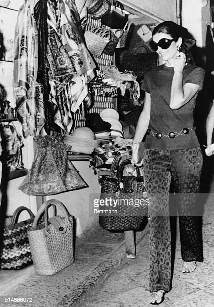 Jacqueline Onassis does some shopping on the Isle of Capri during a Mediterranean pleasure cruise with her husband, Aristotle Onassis, on his yacht...