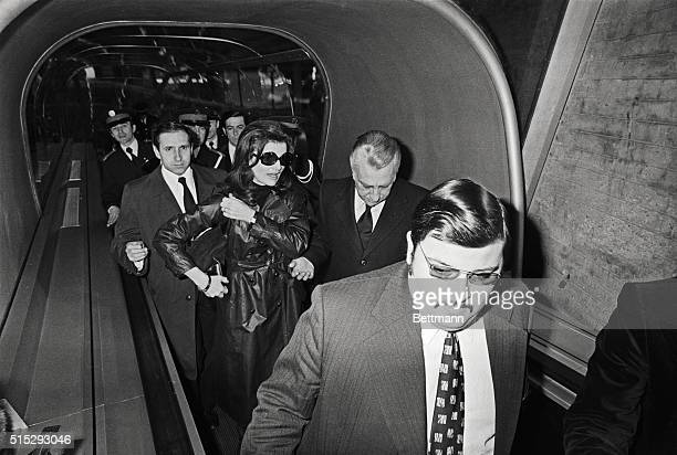 Jacqueline Onassis is shown in Paris at the time of her husband's death Gentlemen with her is unidentified