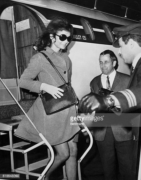 Jacqueline Onassis steps briskly as she leaves a chartered jet here Nov 14th on her first visit outside Greece since her wedding Jackie and her...
