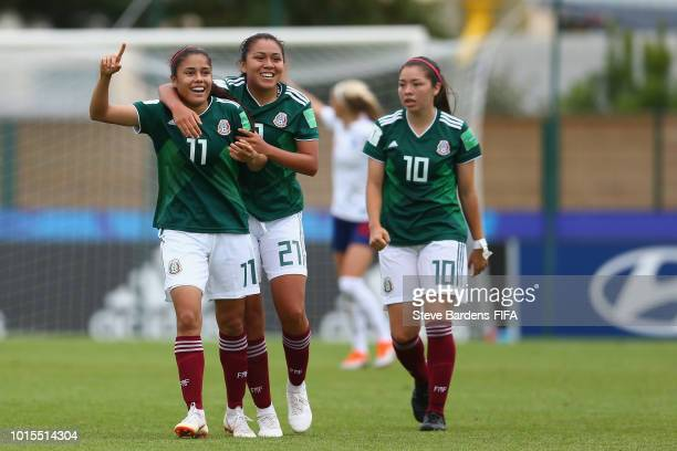 Jacqueline Ovalle of Mexico celebrates scoring a goal with her team mates during the group B match between England and Mexico at Stade de Marville on...