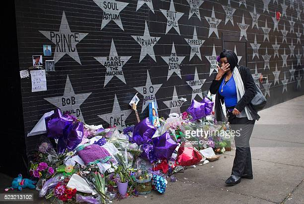 Jacqueline Pruitt wipes away a tear after leaving flowers at a memorial to Prince outside the First Avenue nightclub on April 22 2016 in Minneapolis...