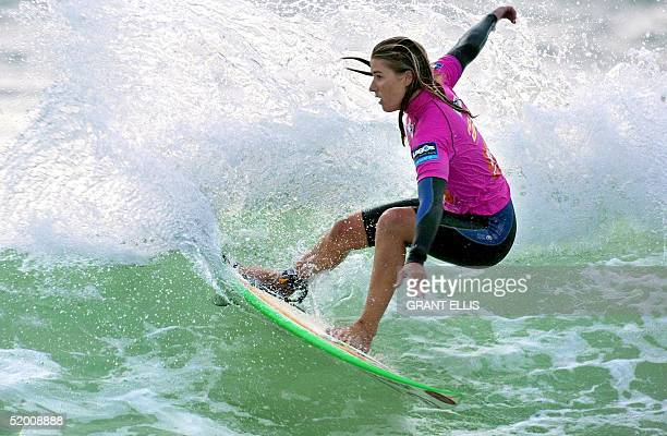 Jacqueline Silva of Brazil rides a wave in the quarterfinals of the Figueira Pro surfing women's competition at Figueira da Foz 21 September 2002 The...