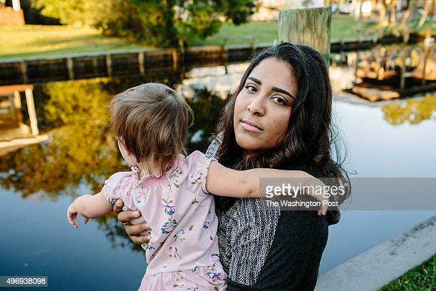 Jacqueline Stokes plays with her daughter Alexandra Stokes in the back yard of their home in a small suburb of Pensacola Florida on November 11 2015...