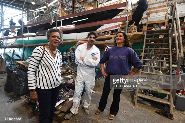 Jacqueline Tabarly and her daughter Marie, the wife and daughter of French international skipper Eric Tabarly, stand along side boatyard foreman...