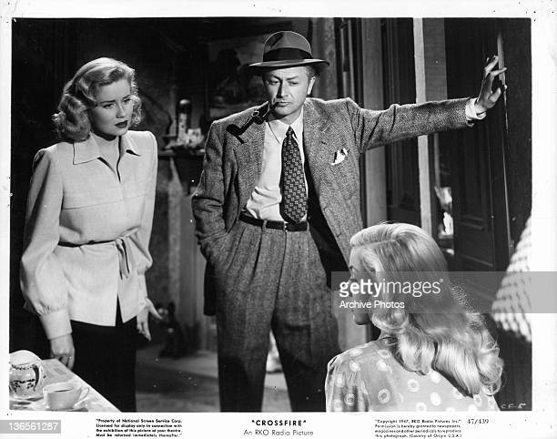 Jacqueline White and Robert Young looking at Gloria Grahame in a scene from the film 'Crossfire' 1947