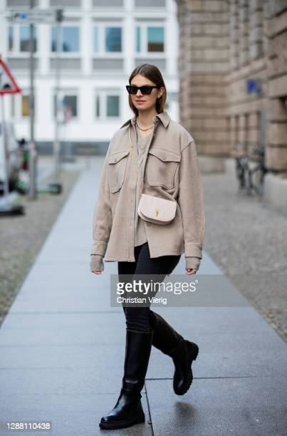 Jacqueline Zelwis is seen wearing Arket jacket in beige Samsoe Samsoe jumper Calvin Klein jeans Bally bag Saint Laurent sunglasses HM boots on...