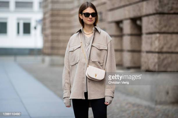 Jacqueline Zelwis is seen wearing Arket jacket in beige Samsoe Samsoe jumper Calvin Klein jeans Bally bag Saint Laurent sunglasseson November 27 2020...