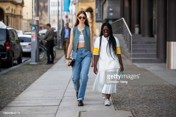 Jacqueline Zelwis is seen wearing Bally vest, white cropped top Zara, Topshop jeans, Bally bag, Flattered shoes, sunglasses Cartier and Lois Opoku is...