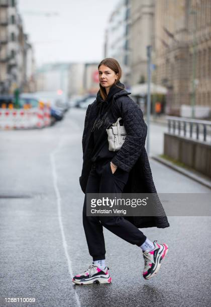 Jacqueline Zelwis is seen wearing black jogger pants and hoody Lala Berlin black puffer coat Brigitte Herskind Balenciaga sneaker 31 Phillip Lim bag...