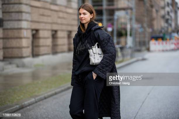 Jacqueline Zelwis is seen wearing black jogger pants and hoody Lala Berlin black puffer coat Brigitte Herskind 31 Phillip Lim bag on November 27 2020...