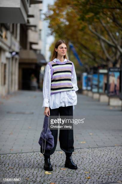 Jacqueline Zelwis is seen wearing black pants Resumè, knitted striped vest, Topshop button shirt, Cala Jade bag in purple, Ray Ban sunglasses, Total...