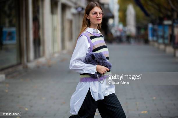 Jacqueline Zelwis is seen wearing black pants Resumè, knitted striped vest, Topshop button shirt, Cala Jade bag in purple, Ray Ban sunglasses on...