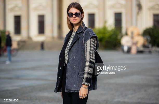Jacqueline Zelwis is seen wearing dark denim vest Gestuz, shirt with print Cecilie Copenhagen, black pants Holzweiler, Gigi Studios sunglasses, Prada...