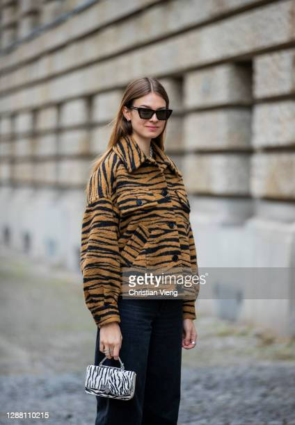 Jacqueline Zelwis is seen wearing jacket with animal print Lala Berlin Levis denim jeans Weat bag with zebra print Saint Laurent sunglasses on...