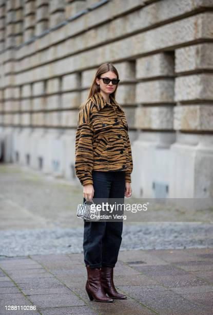 Jacqueline Zelwis is seen wearing jacket with animal print Lala Berlin Levis denim jeans Weat bag with zebra print Toral cowboy boots Saint Laurent...